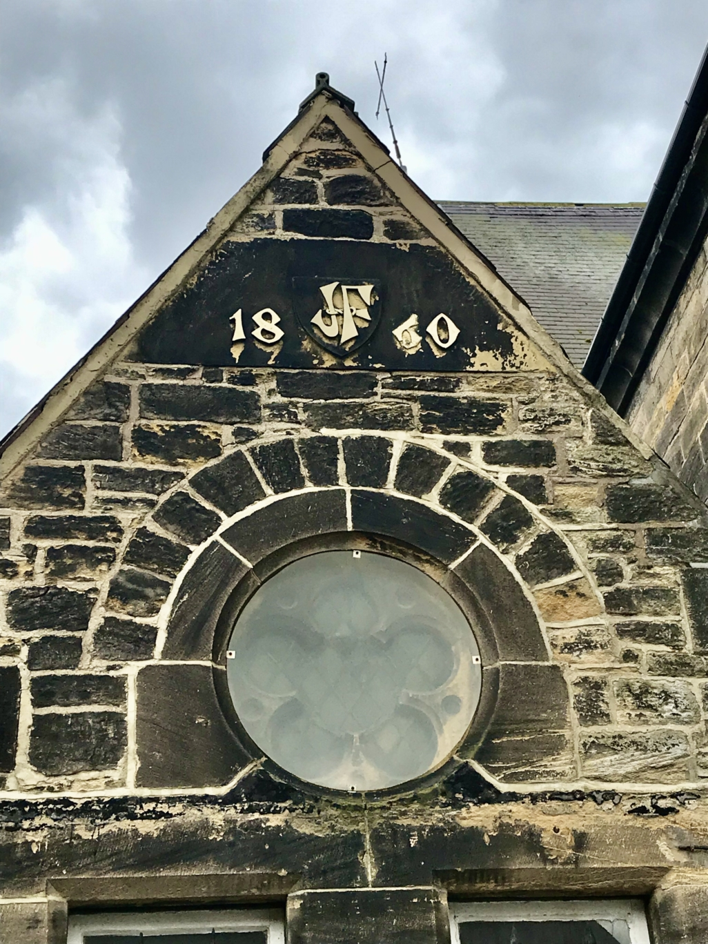 On the outside wall of the presbytery at St. Anthony's you can see the initials JF emblazoned on a shield and the date 1860 cut out of the stonework